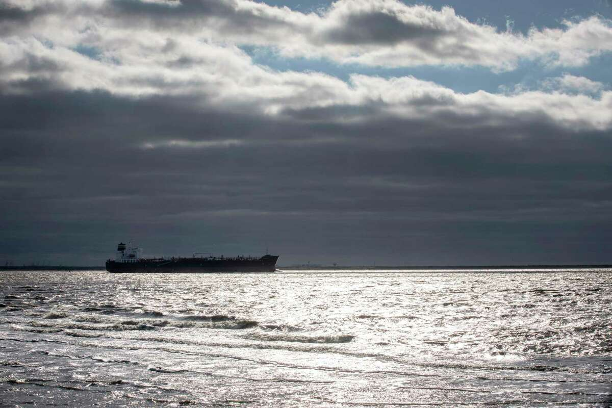 An ocean-going tanker passes through the Texas City Channel, Friday, in 2018, in Port Bolivar.