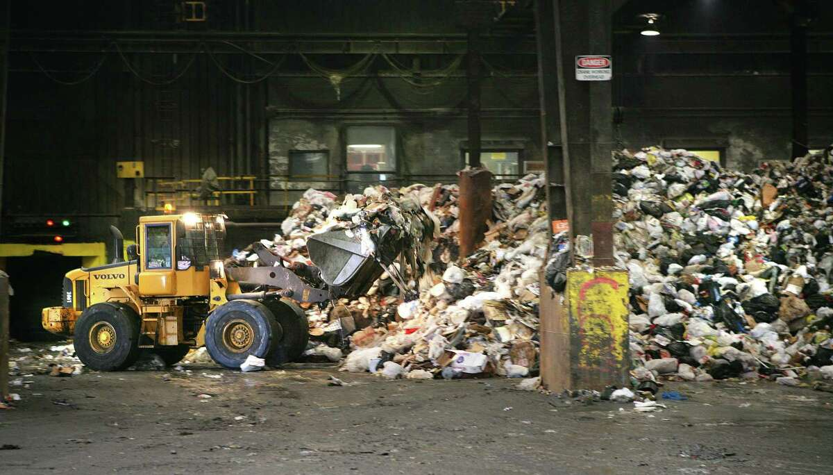 A loader moves trash at the Covanta Trash-to-Energy plant in Wallingford.