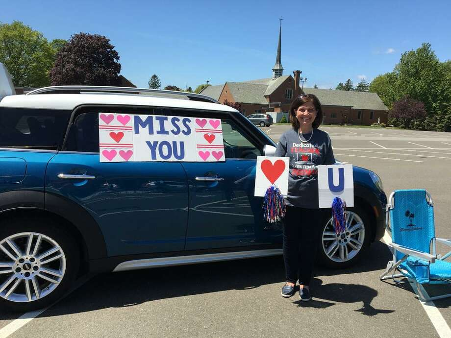 Teachers at St. Mary School in Milford set up their cars in the parking lot to say goodbye to students for the summer, after having been separated by the Coronavirus pandemic. Photo: Contributed Photo / Milford Mirror Contributed