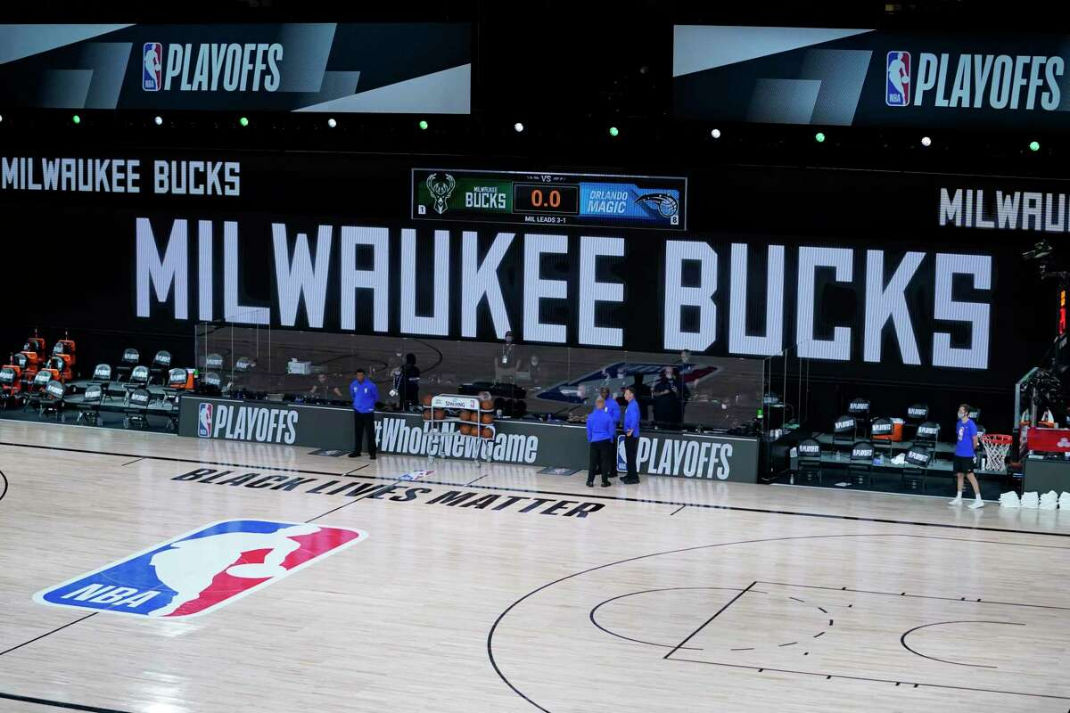 Officials stand beside an empty court after the scheduled start of game five between the Milwaukee Bucks and the Orlando Magic in the first round of the 2020 NBA Playoffs at AdventHealth Arena at ESPN Wide World Of Sports Complex on August 26, 2020 in Lake Buena Vista, Florida. According to reports, the Milwaukee Bucks have boycotted their game 5 playoff game against the Orlando Magic to protest the shooting of Jacob Blake by Kenosha, Wisconsin police.
