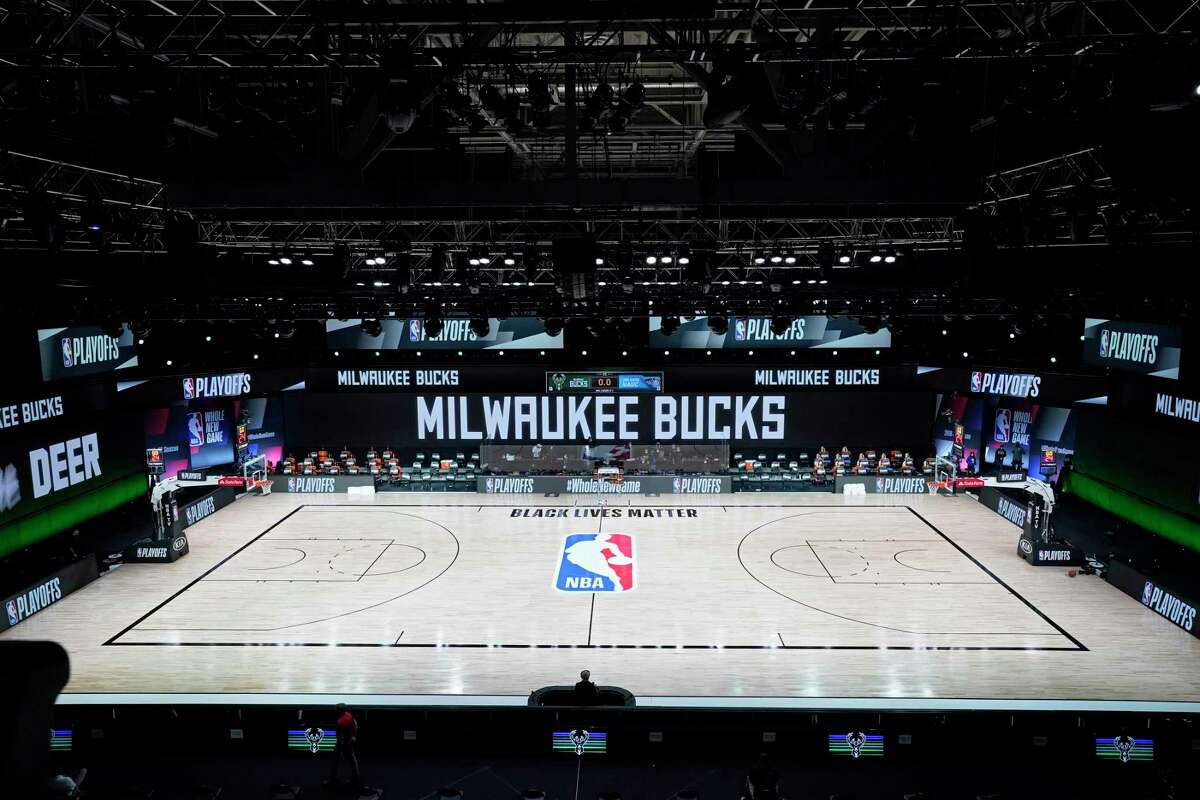 The court and benches are empty after the scheduled start of game five between the Milwaukee Bucks and the Orlando Magic in the first round of the 2020 NBA Playoffs at AdventHealth Arena at ESPN Wide World Of Sports Complex on August 26, 2020 in Lake Buena Vista, Florida. According to reports, the Milwaukee Bucks have boycotted their game 5 playoff game against the Orlando Magic to protest the shooting of Jacob Blake by Kenosha, Wisconsin police.