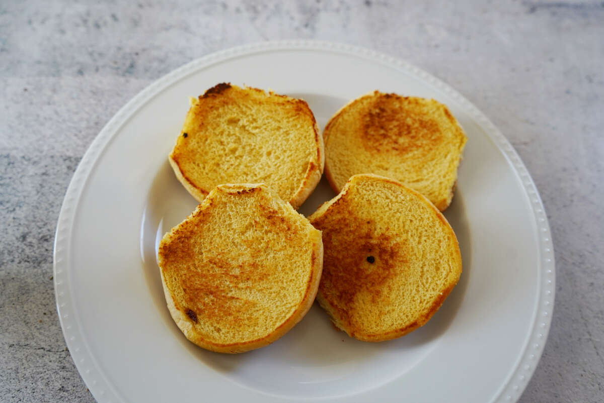 The recipe I used by Serious Eats called for oven toasted buns, plus a quick one-minute toast on a non-stick skillet. The result was golden, slightly crispy buns.