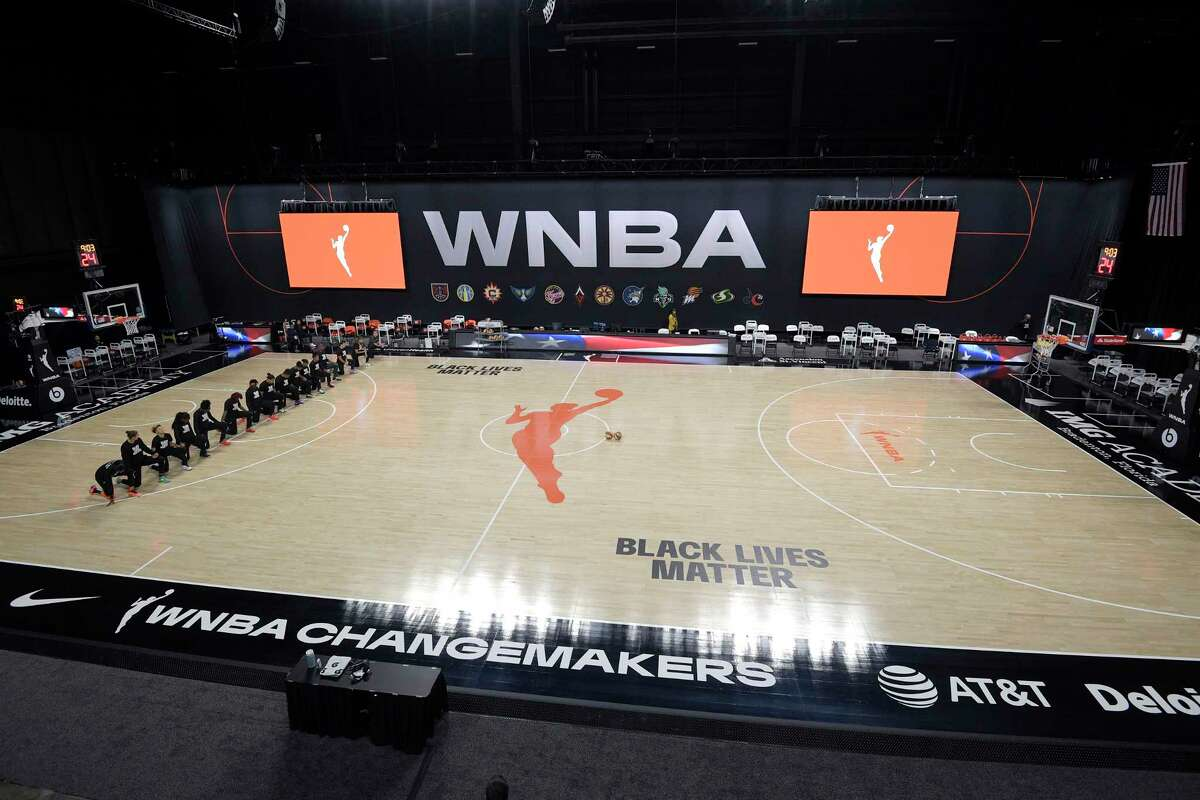 Members of the Connecticut Sun kneel during the playing of the national anthem before a WNBA basketball game against the Indiana Fever, Tuesday, Aug. 18, 2020, in Bradenton, Fla. The members of the Indiana Fever left the court before the song was played. (AP Photo/Phelan M. Ebenhack)