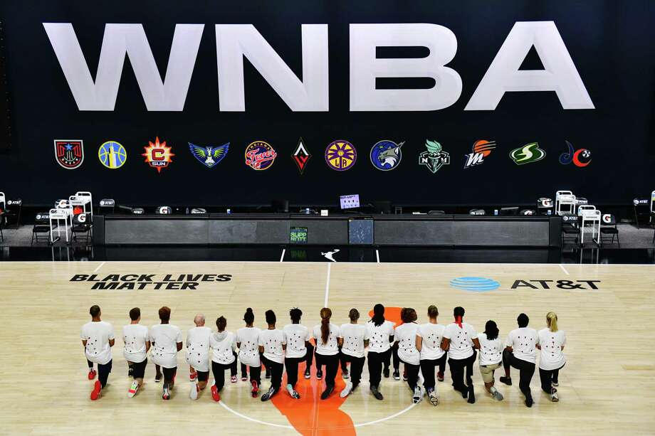 PALMETTO, FLORIDA - AUGUST 26: After the WNBA announcement of the postponed games for the evening, the Washington Mystics each wear white T-shirts with seven bullets on the back protesting the shooting of Jacob Black by Kenosha, Wisconsin police at Feld Entertainment Center on August 26, 2020 in Palmetto, Florida. NOTE TO USER: User expressly acknowledges and agrees that, by downloading and or using this photograph, User is consenting to the terms and conditions of the Getty Images License Agreement. (Photo by Julio Aguilar/Getty Images) Photo: Julio Aguilar / Getty Images / 2020 Julio Aguilar 2020 Julio Aguilar