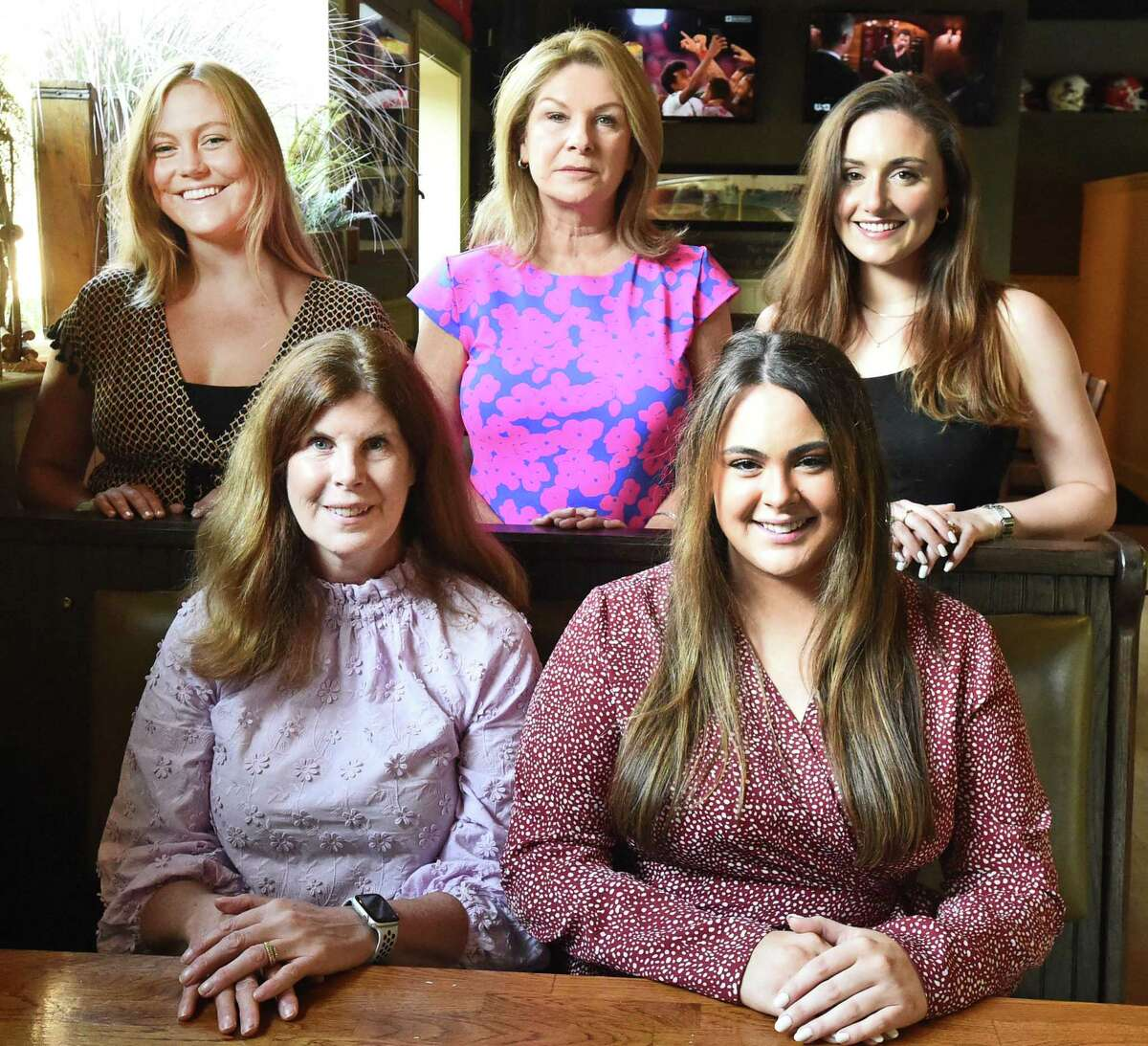 Lisa Deane, third from left, a Madison mother who founded DemandZero with the DemandZero committee of Fione Firene and Isabelle Firine both of New Haven, sitting, and standing, left to right, Tory Cornell of Madison, Lisa Deane and Kelsey Handelman of Madison on Friday, Aug. 20. The committee was instrumental in an effort to commission a New Haven architectural and design company to craft a sculpture in Hartford that will include the signatures of 79 people from CT, with room to add more signatures, who have died due to an overdose of opioids. The purpose of the sculpture is to remind people that the opioid epidemic rages on, and to put pressure on legislators to pass critical laws that address the epidemic.