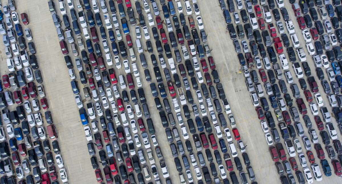 People wait in their cars Thursday, April 9, 2020, at Traders Village for the San Antonio Food Bank to begin food distribution.