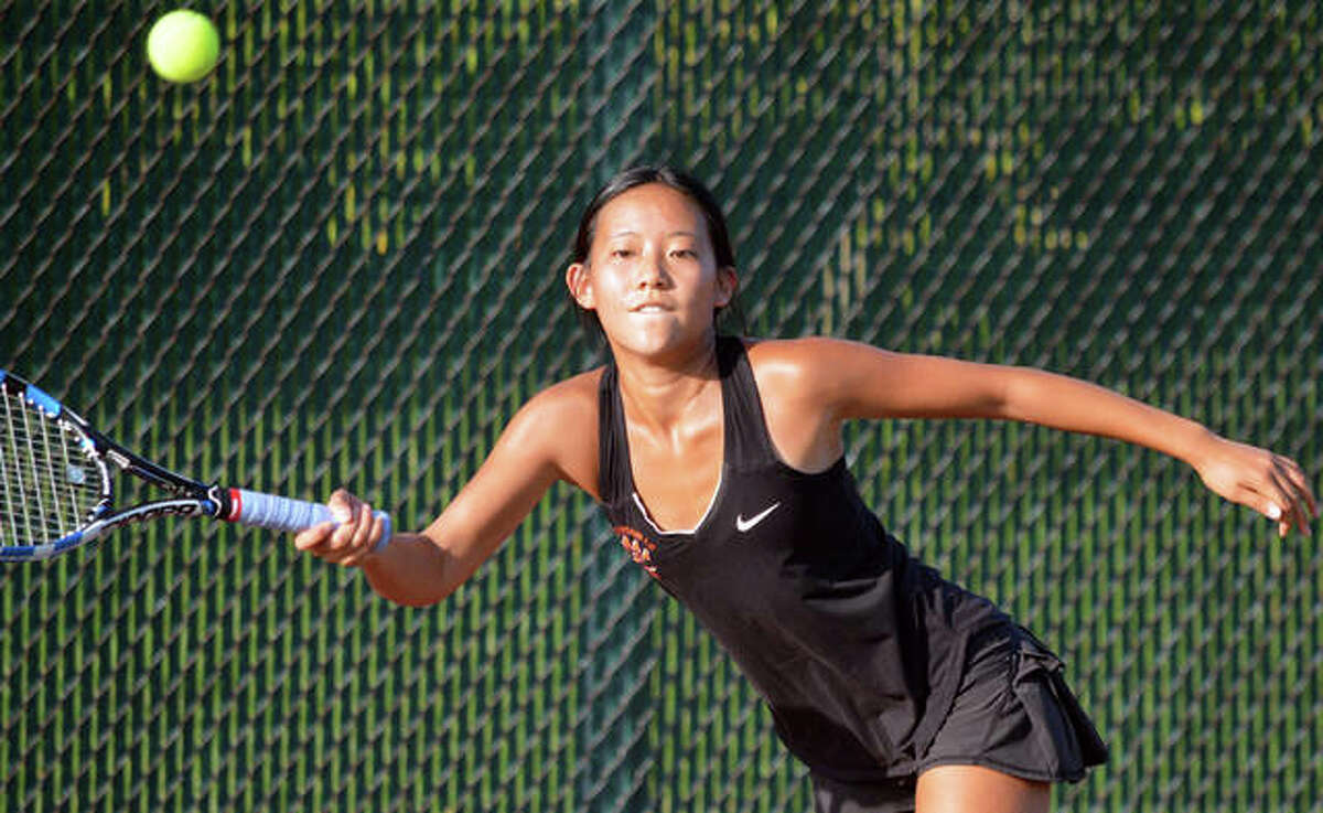 Edwardsville's Eileen Pan reaches for a forehand return during her No. 2 singles match in Wednesday's season opener against Highland at the EHS Tennis Center.