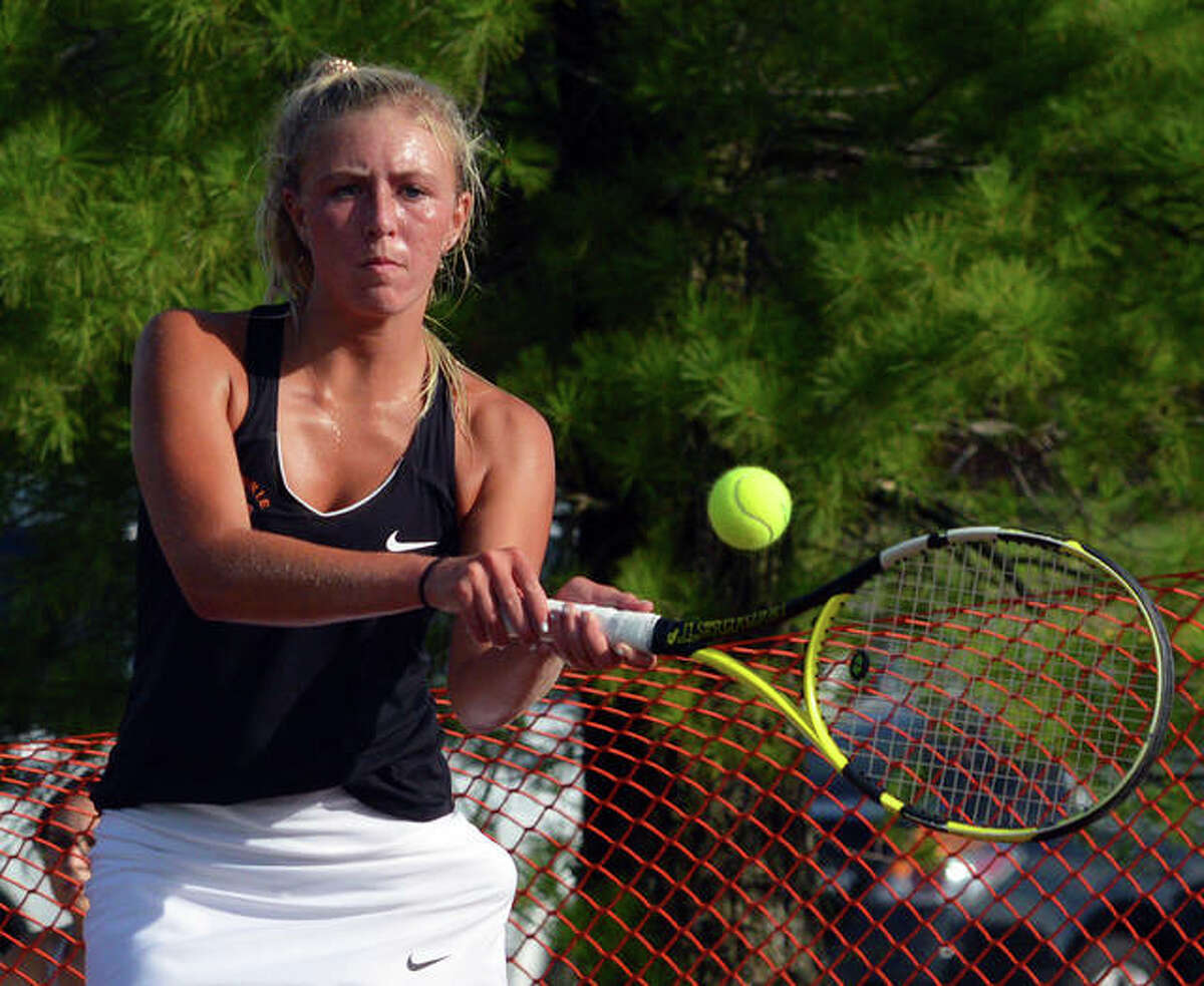 Edwardsville's Emma Herman hits a two-handed backhand during her No. 1 singles match in Wednesday's season opener against Highland at the EHS Tennis Center.
