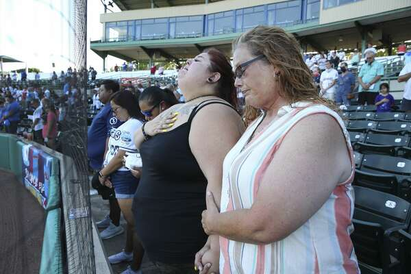 Shannon Terry (right) and her daughter Cheyenne Doria become emotional as they attend a baseball game at Wolff Stadium on Friday, July 10, 2020 to honor Terry's father-in-law Willie Doria who died from complications of Covid-19.