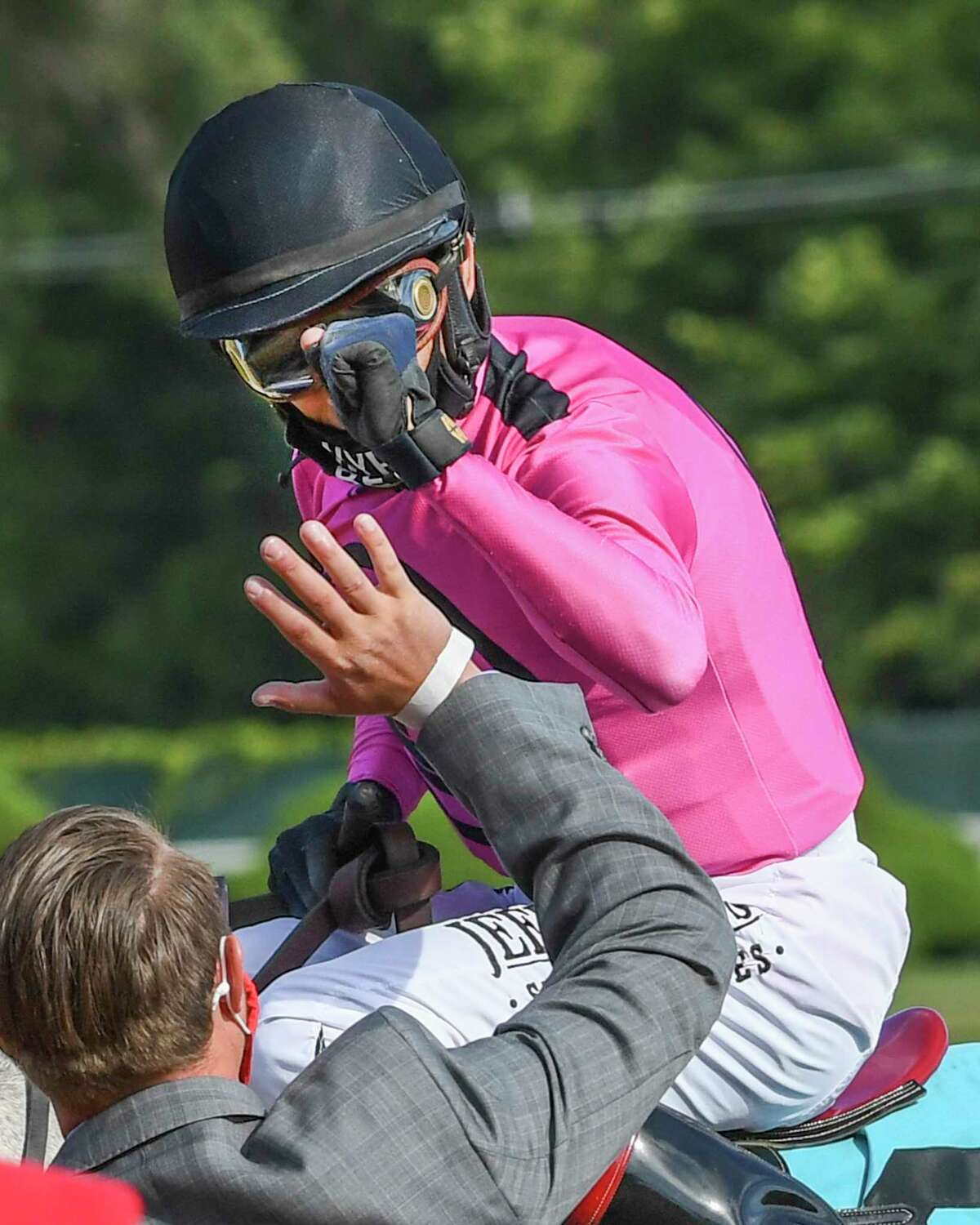 Jockey John Velazquez gets an air high five from assistant trainer Jaime Begg after he rode Jack and Noah to the win in the 2nd running of The Mahony Wednesday Aug.26, 2020 at the Saratoga Race Course in Saratoga Springs, N.Y. Photo by Skip Dickstein/Special to the Times Union