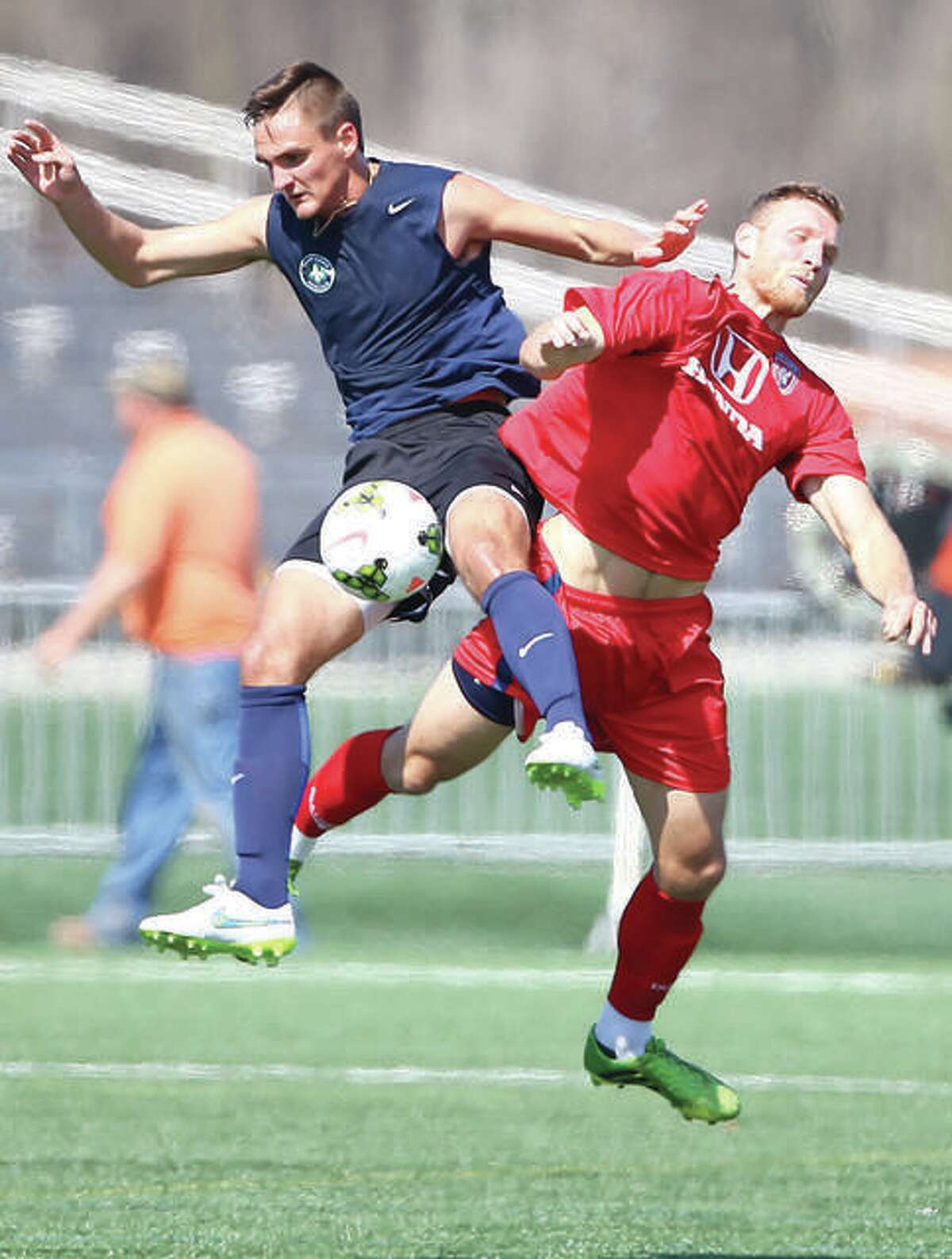 Saint Louis FC's Sam Fink, left, goes up for a ball with a forward from the Indianapolis Eleven in a friendly match in 2015 at St. Louis Soccer Park.