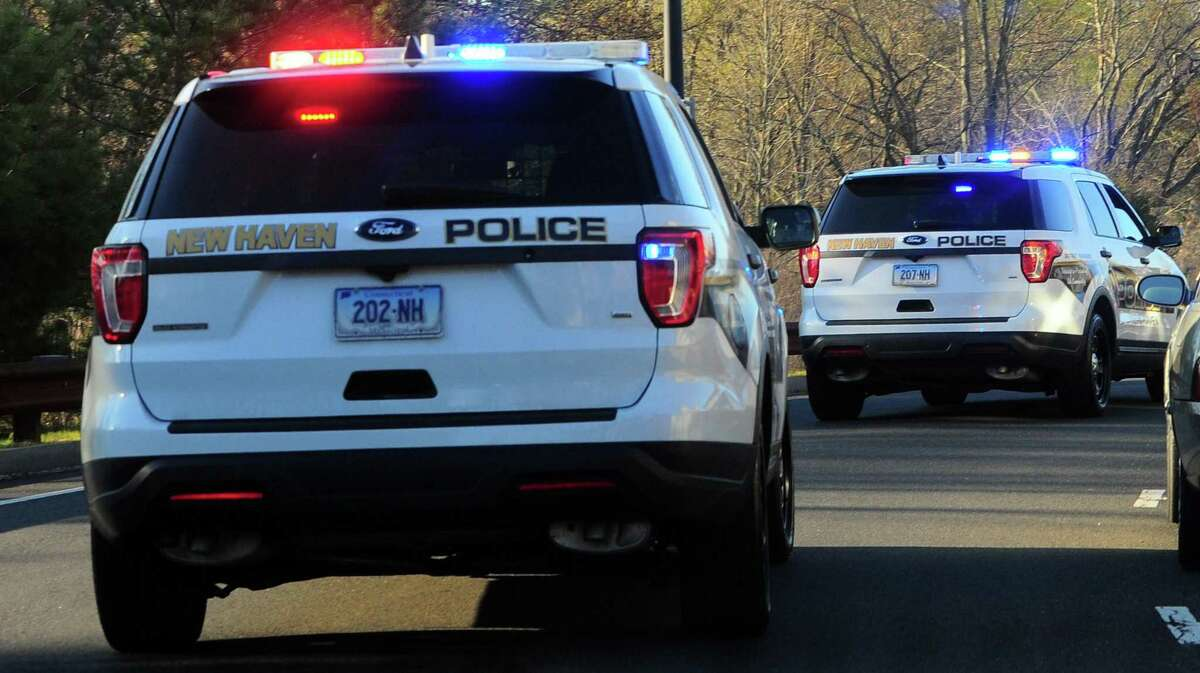 File photo of New Haven, Conn., police cruisers, taken in April 2020.