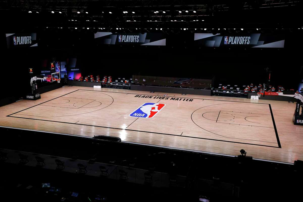 An empty court and bench is shown with no signage Wednesday following the scheduled Game 5 start time for the Bucks and Magic at the ESPN Wide World Of Sports Complex in Lake Buena Vista, Florida.