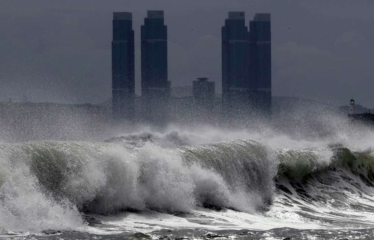 High waves crash onto Haeundae Beach in Busan, South Korea, Wednesday, Aug. 26, 2020, as Typhoon Bavi approaches the Korean Peninsula. Hundreds of flights were canceled in South Korea while North Korea's leader expressed concern about a potential loss of lives and crops as the countries braced for a fast-approaching typhoon forecast as one of the strongest to hit their peninsula this year.(Jo Jong-ho/Yonhap via AP)