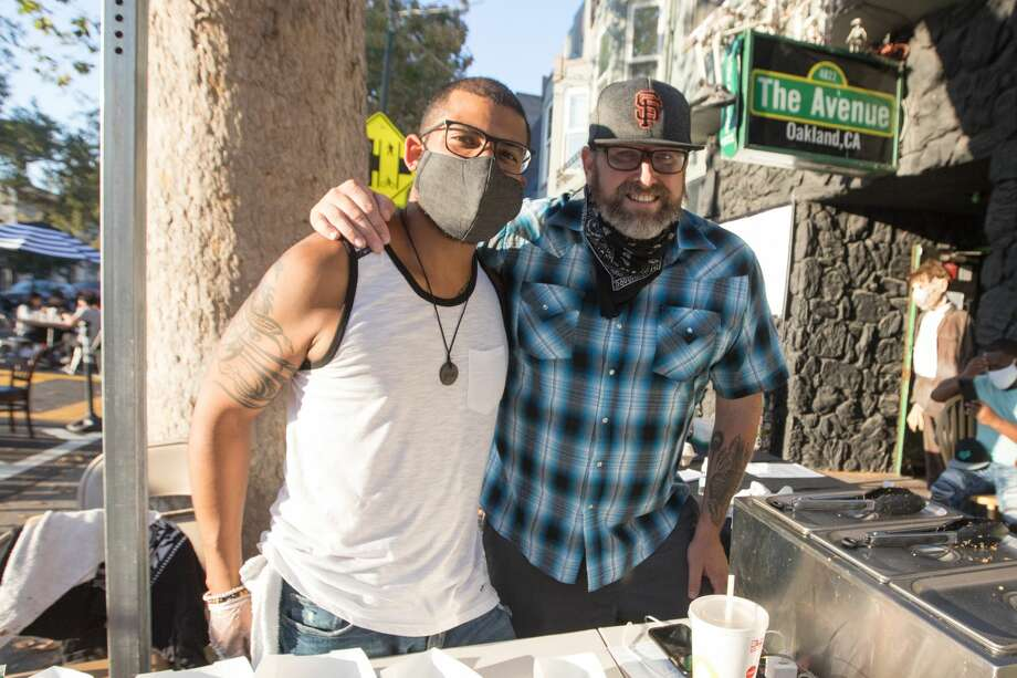 (Left to right) Mario Camargo and Chris Parks run Blake's Grillery, which helps bars with patios fulfill the requirement to become restaurants. They were serving tacos to customers at The Avenue on Temescal Avenue on Aug. 19, 2020 in Oakland, Calif. Photo: Douglas Zimmerman/SFGATE / SFGATE