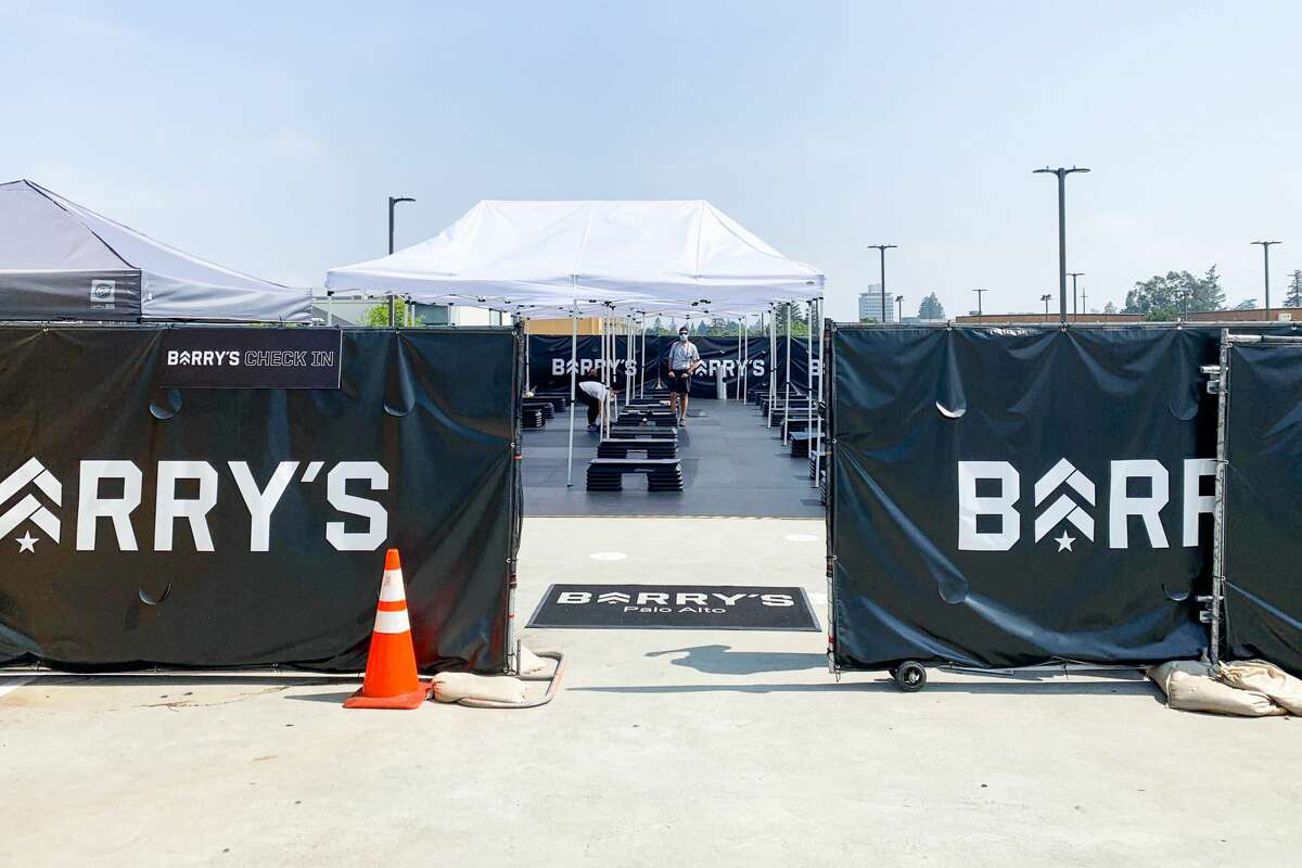 Barry's Bootcamp is holding classes at the company's Palo Alto location on top of the Stanford Shopping Center rooftop parking lot.