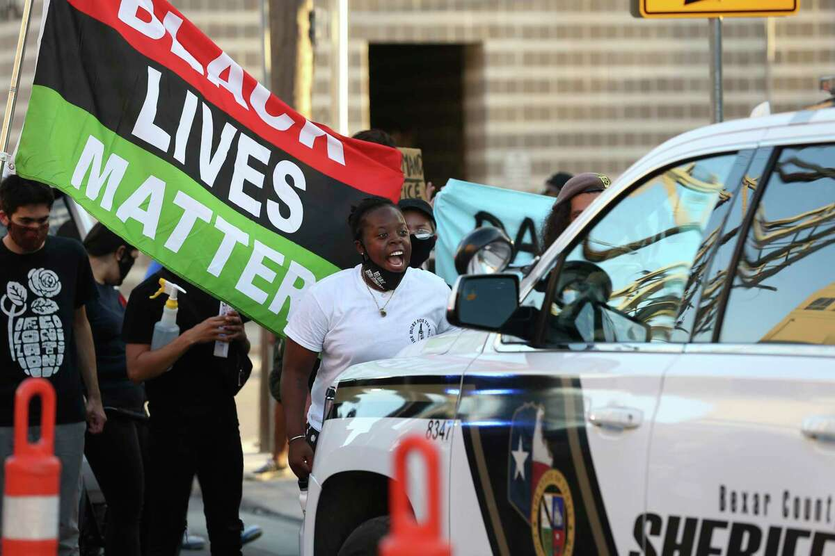 Protesters surround a Bexar County sheriff's unit outside the jail. The group gathered Wednesday to protest the death of Damian Lamar Daniels, who was shot during a confrontation with deputies.