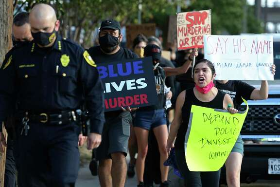Protesters follow Bexar County Sheriff Javier Salazar after he tried talking with them during a protest outside the jail in August. The group was protesting the killing of Damien Lamar Daniels, a Black veteran shot by sheriff's Deputy John Rodriguez.