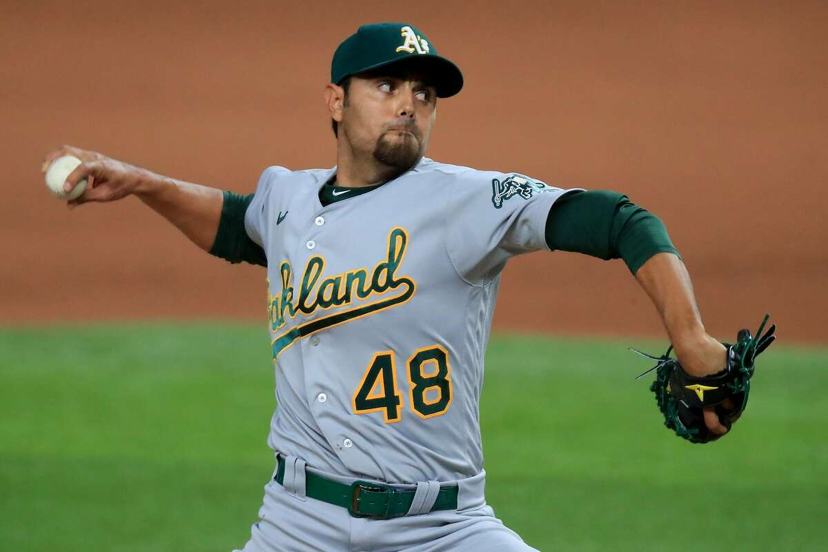 ARLINGTON, TEXAS - AUGUST 26: Joakim Soria #48 of the Oakland Athletics pitches against the Texas Rangers in the bottom of the seventh inning at Globe Life Field on August 26, 2020 in Arlington, Texas. (Photo by Tom Pennington/Getty Images)
