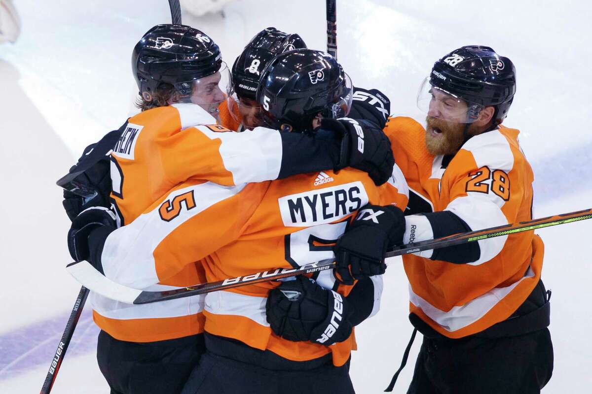 Philadelphia Flyers defenceman Philippe Myers (5) celebrates his game-winning goal in overtime with teammates during overtime in an NHL Stanley Cup Eastern Conference playoff hockey game against the New York Islanders in Toronto, Ontario, Wednesday, Aug. 26, 2020. (Cole Burston/The Canadian Press via AP)