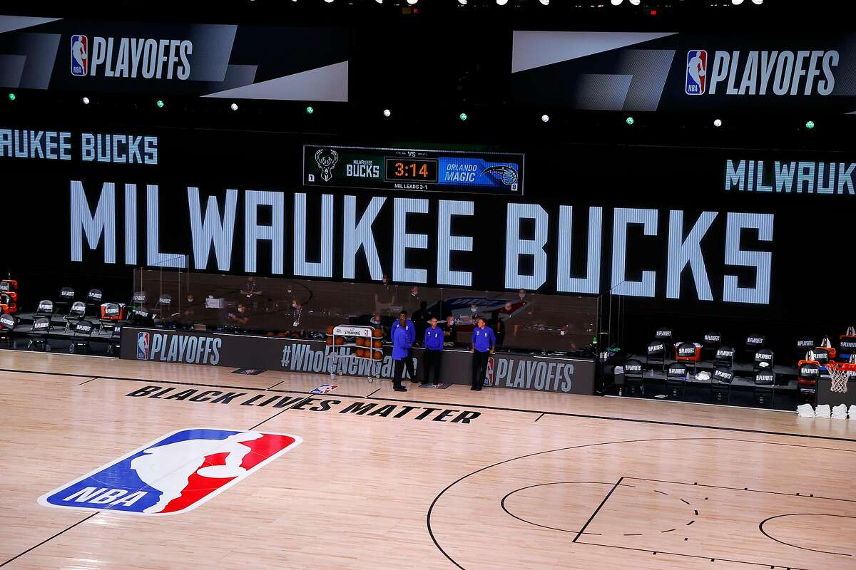 Referees stand on an empty court before the start of a scheduled game between the Milwaukee Bucks and the Orlando Magic for Game Five of the Eastern Conference First Round during the 2020 NBA Playoffs at AdventHealth Arena at ESPN Wide World Of Sports Complex on August 26, 2020 in Lake Buena Vista, Florida. (Photo by Kevin C. Cox/Getty Images)