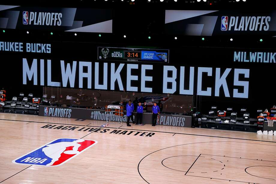 Referees stand on an empty court before the start of a scheduled game between the Milwaukee Bucks and the Orlando Magic for Game Five of the Eastern Conference First Round during the 2020 NBA Playoffs at AdventHealth Arena at ESPN Wide World Of Sports Complex on August 26, 2020 in Lake Buena Vista, Florida. (Photo by Kevin C. Cox/Getty Images) Photo: Kevin C. Cox, Getty Images