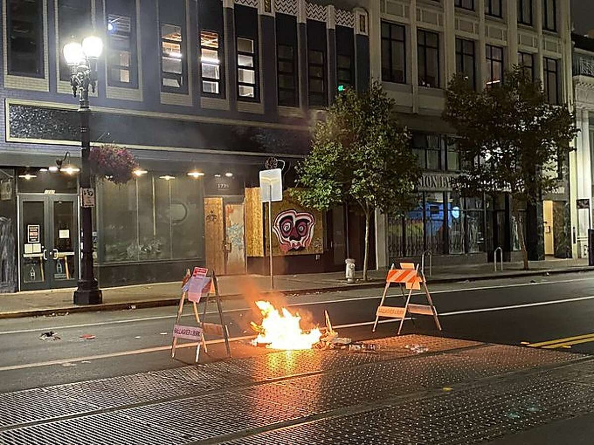 Photos and video shared on the Oakland Police Department Twitter page shows tipped over trashcans sprawled in the middle of the street, and two small fires surrounded by traffic cones on Wednesday, Aug. 26, 2020.