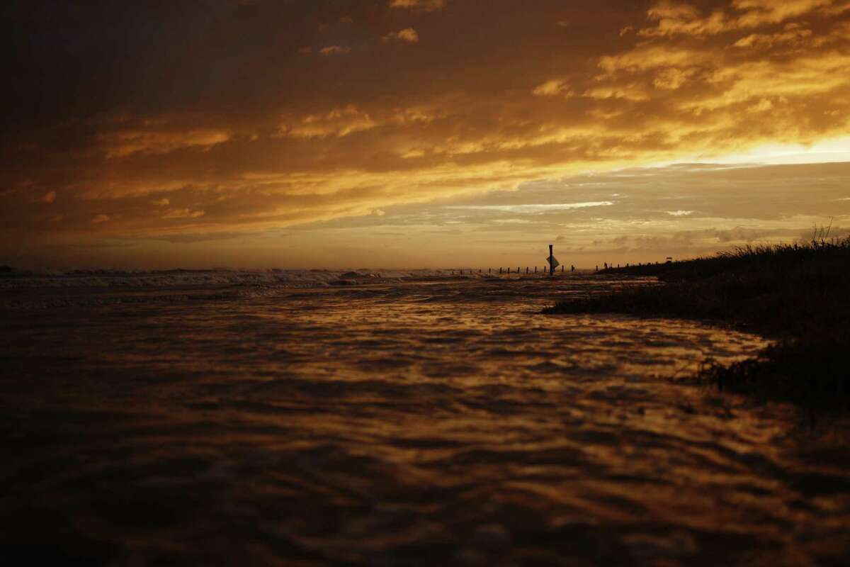 The sun sets at Crystal Beach ahead of Hurricane Laura in Sabine, Texas, U.S., on Wednesday, Aug. 26, 2020. Hurricane Laura is poised to become a Category 4 storm that could wreak catastrophic damage in Texas and Louisiana, bringing a life-threatening storm surge, flash flooding and destructive winds that could leave areas uninhabitable for weeks or months. Photographer: Luke Sharrett/Bloomberg