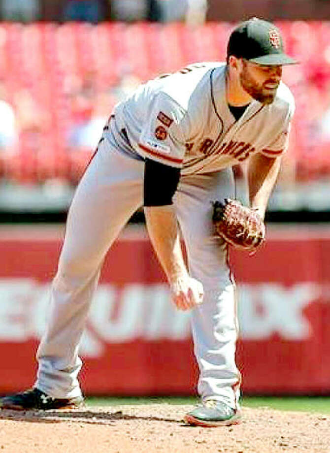 Carrollton High graduate Sam Coonrod of the San Francisco Giants looks in for a sign from his catcher a game against the Cardinals at Busch Stadium.Coonrod has returned to the active roster after spending much of August on the Injured Reserved list with a lat strain.