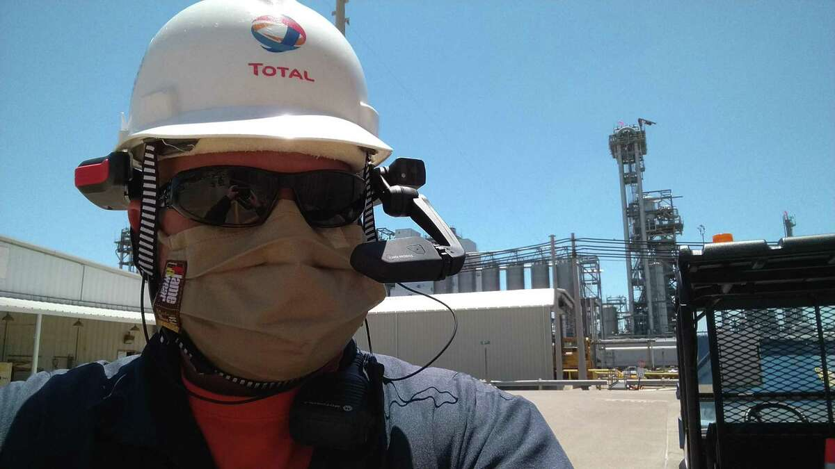 A test of high-tech helmets at French oil major Total's petrochemical plant in La Porte has led the company to deploy them as a COVID-19 safety measure at its facilities around the world.