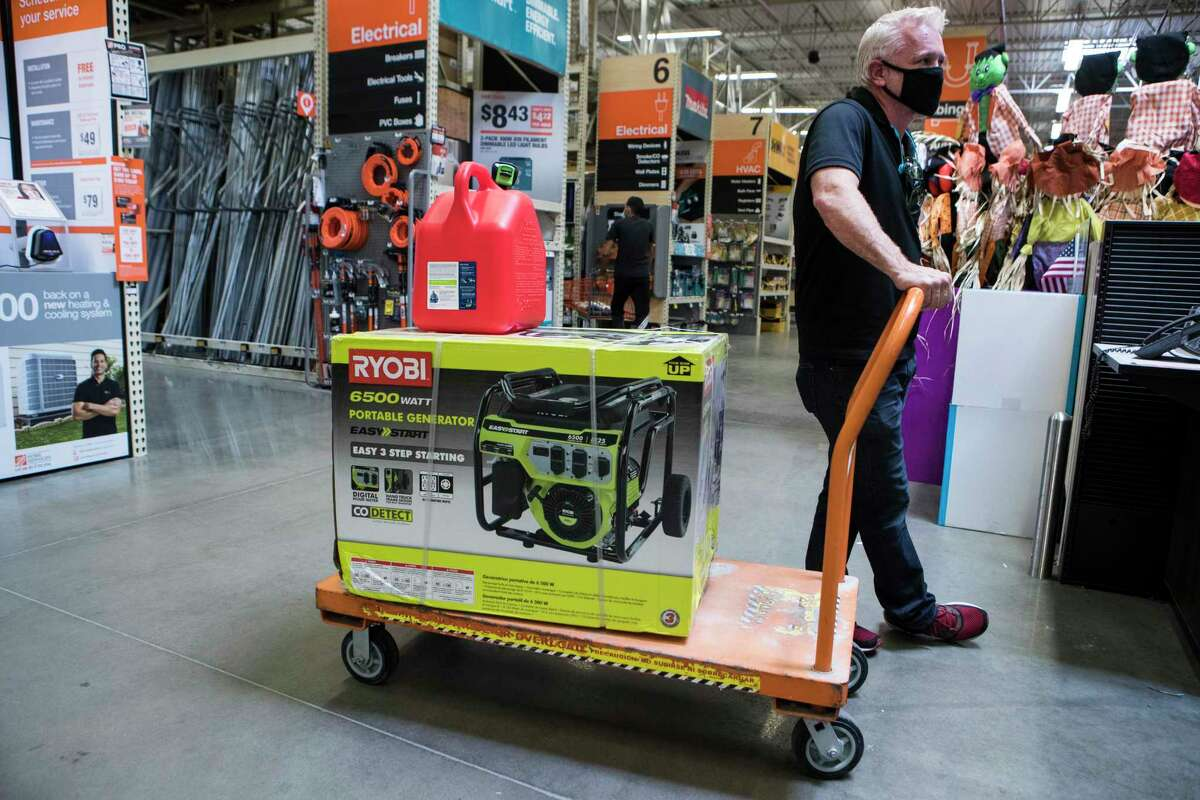 Steve Priddy waits in line at the checkout stand to purchase a portable generator at a Home Depot store while preparing for the possible landfall of Hurricane Laura on Tuesday, Aug. 25, 2020 in Houston. The city and Harris County were spared any significant damage after Laura came ashore overnight in western Louisiana.