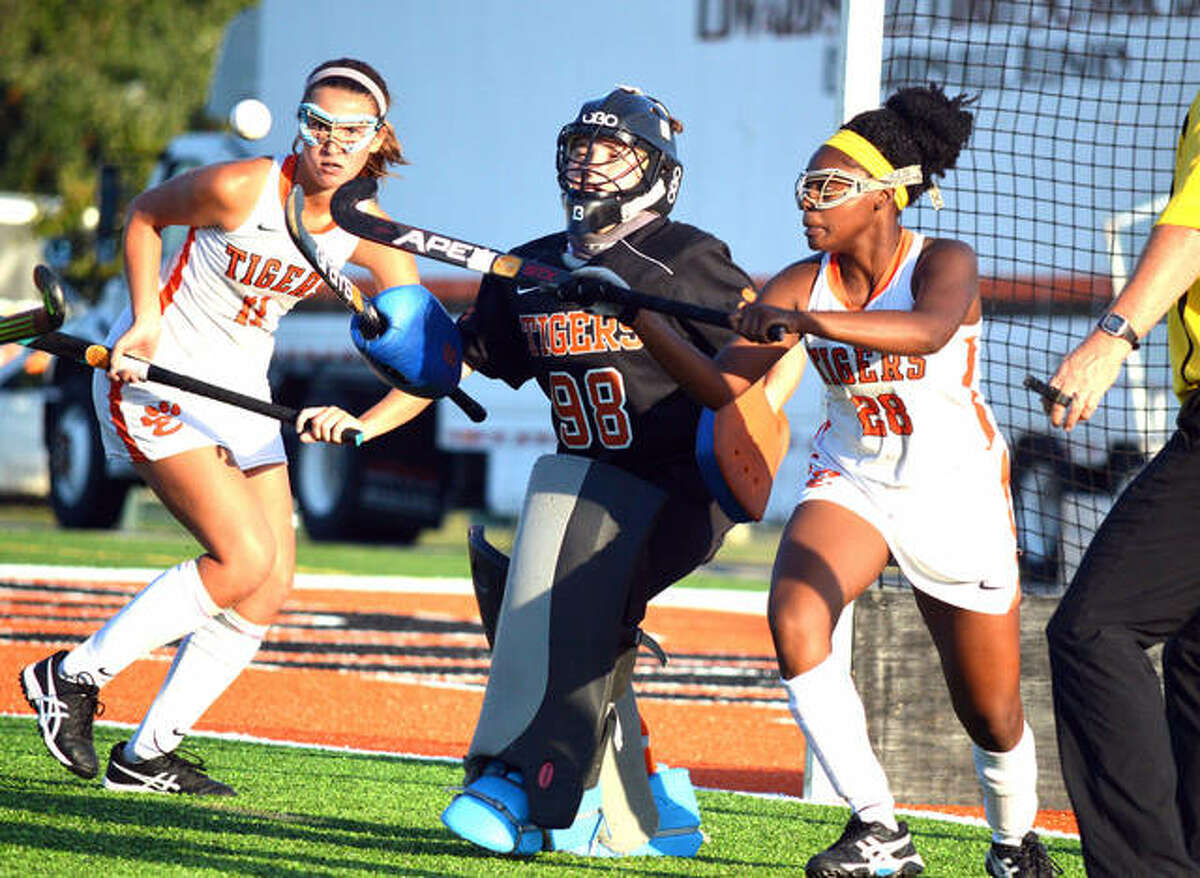 Edwardsville defender Gabbi Trauernicht, left, provides coverage during a play in front of the Edwardsville goal in a game inside the District 7 Sports Complex.