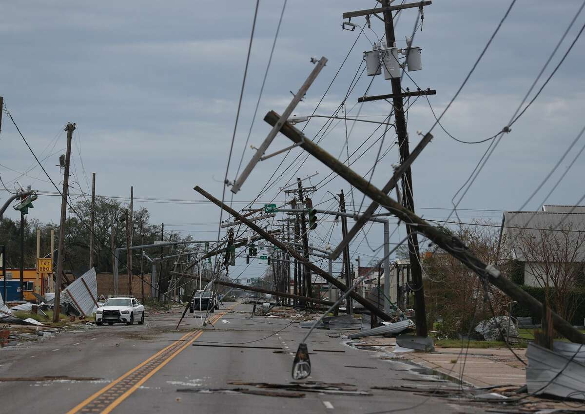 A street is seen strewn with debris and downed power lines after Hurricane Laura passed through the area on August 27, 2020 in Lake Charles, Louisiana . The hurricane hit with powerful winds causing extensive damage to the city. (Photo by Joe Raedle/Getty Images)