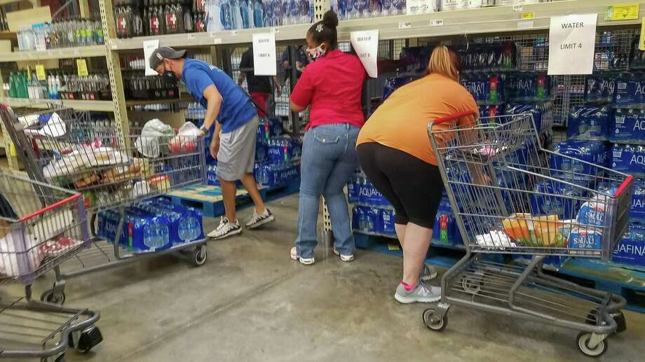 People at HEB Plus on Dowlen Road were getting the maximum number of cases of water just in case. With two storms churning in the Gulf of Mexico, folks in Southeast Texas were out picking up what they may need if the bad weather hits the area. Photo made on August 22, 2020. Fran Ruchalski/The Enterprise Photo: Fran Ruchalski, The Enterprise / The Enterprise / © 2020 The Beaumont Enterprise