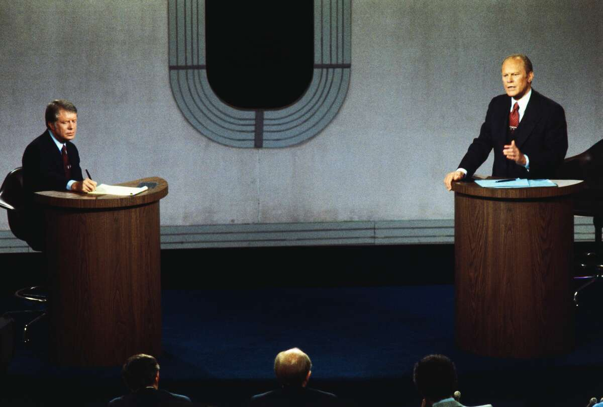 (Original Caption) San Francisco: Jimmy Carter (L) takes notes as Pres. Ford makes a point during the second of the presidential debates at the Palace of Fine Arts.