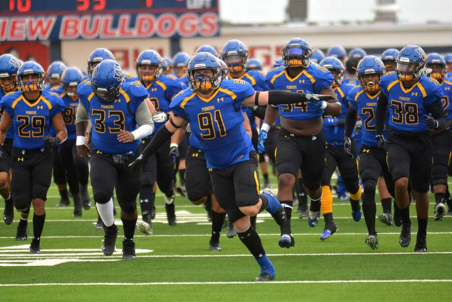 William Humphrey leads the Wayland Baptist football team onto the field before a Sooner Athletic Conference football game last season. Photo: Nathan Giese/Planview Herald