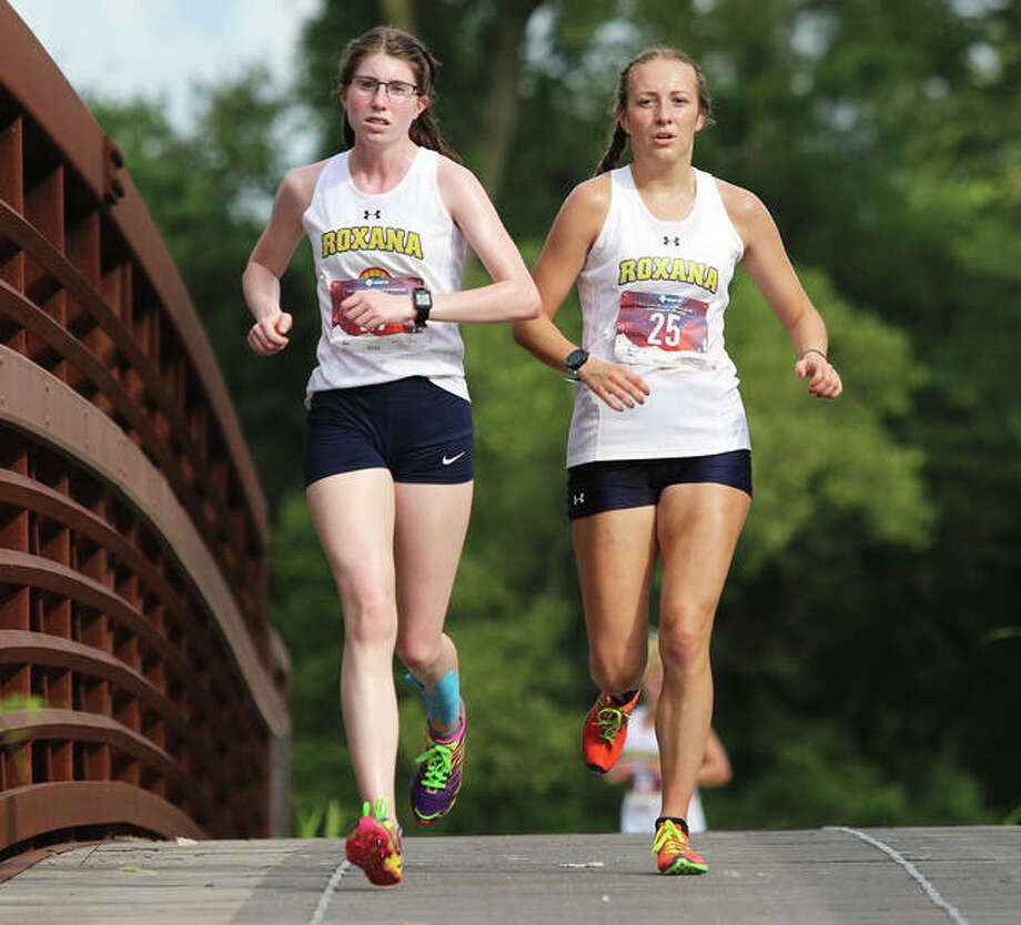 Roxana's Janelynn Wirth (right) and Riley Doyle are first over the bridge late in the second mile at the Bethalto Sports Complex in the AD Cup cross country meet Wednesday in Bethalto. Photo: Greg Shashack / The Telegraph