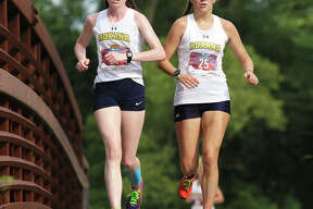 Roxana's Janelynn Wirth (right) and Riley Doyle are first over the bridge late in the second mile at the Bethalto Sports Complex in the AD Cup cross country meet Wednesday in Bethalto.