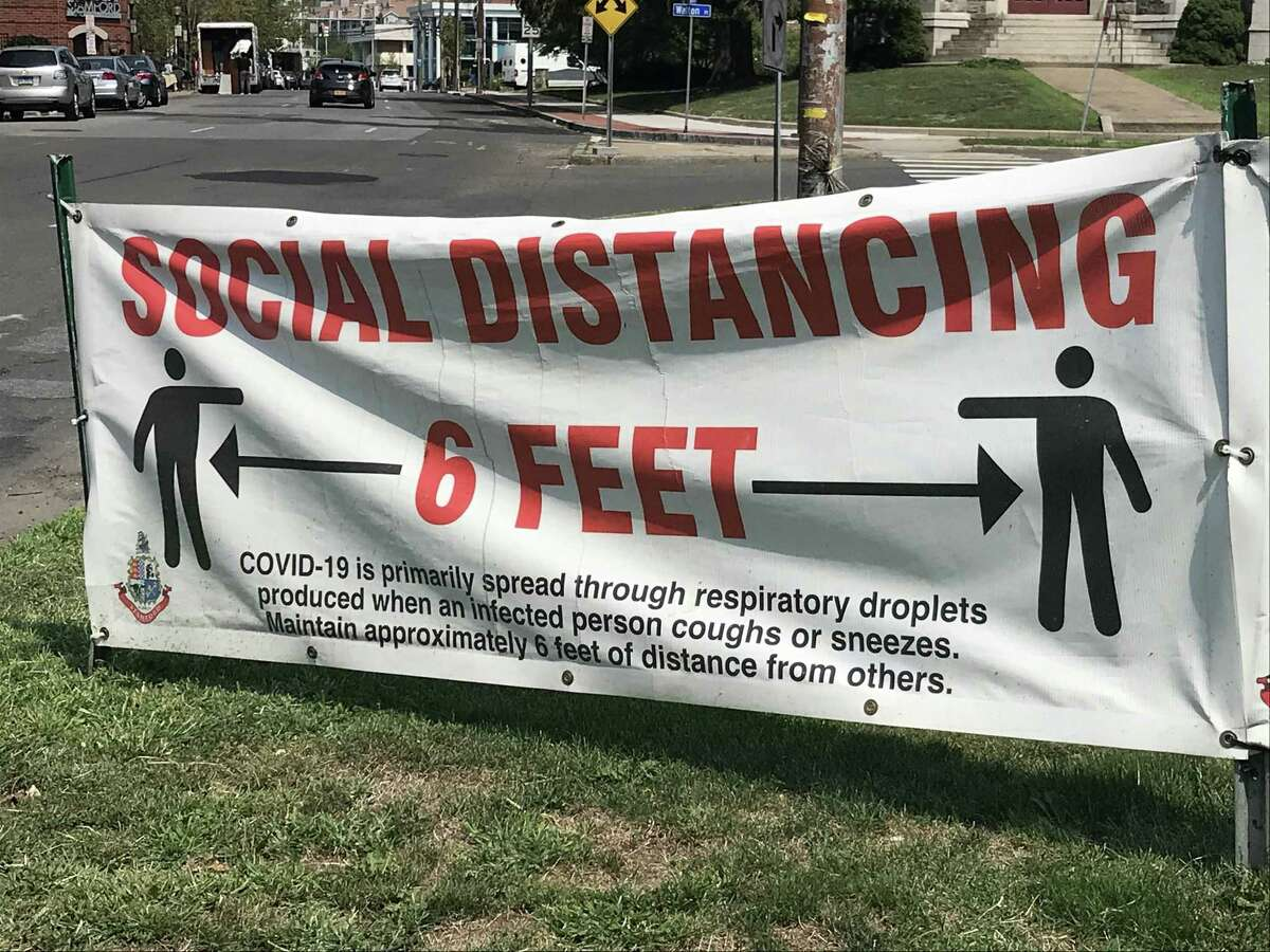 A sign advising residents to maintain 6 feet of distance, seen in Stamford. The six-foot distance you have been adhering to is bunk and not based in modern science at all. In fact, any standardized rule for distance is