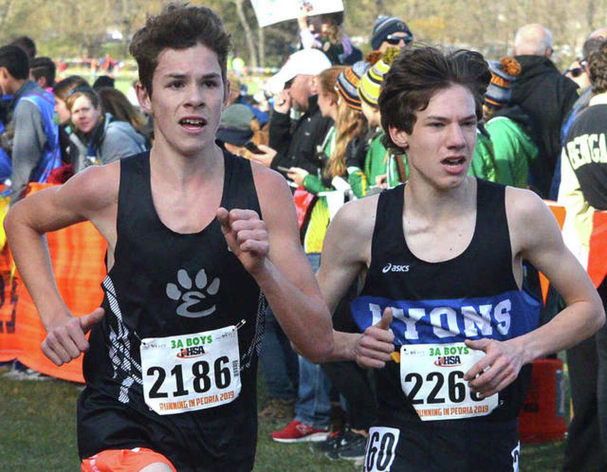 Edwardsville's Geordan Patrylak, left, runs toward the finish line in last year's Class 3A state meet at Detweiller Park in Peoria.