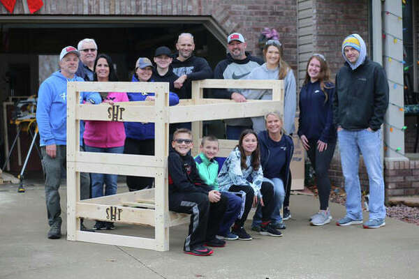 Volunteers with the Alton Chapter of Sleep in Heavenly Peace, a national organization supplying beds for kids ages 3 to 17. With anywhere from 10 to 15 regular volunteers and 40 to 50 volunteers on scheduled build days, the local chapter is able to build up to 40 beds in a three hour period of time. Volunteers gather for a groyp photo at the Alton Chapter of Sleep in Heavenly Peace, a national organization supplying beds for kids ages 3 to 17. With 10-15 regular volunteers and 40-50 volunteers on scheduled build days, the local chapter is able to create up to 40 beds in a three-hour period.