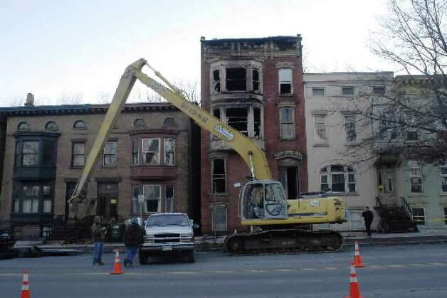 Workers prepare to demolish 598 Madison Ave., Albany, on Dec. 12, 2007, after a fire destroyed the building. (Times Union archive)