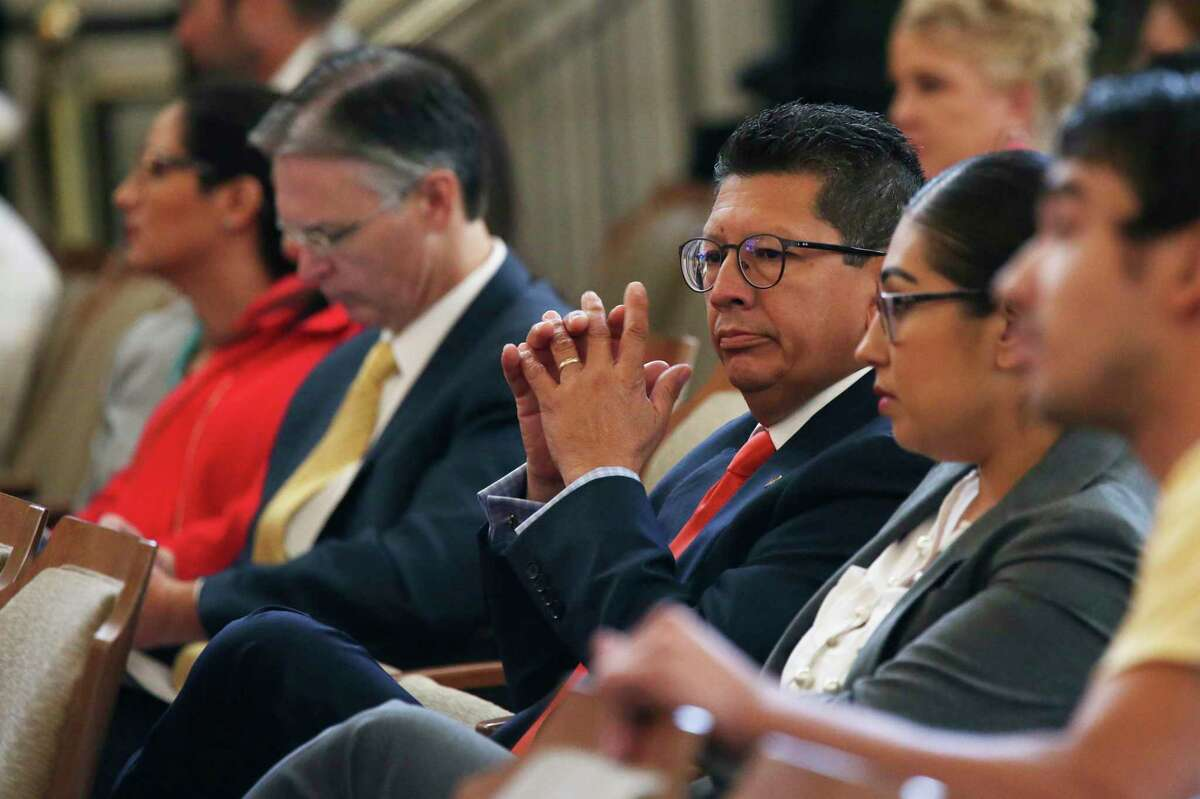 San Antonio Chamber of Commerce President and CEO Richard Perez sits in the audience in 2018 as City Council approves an ordinance mandating paid sick time.