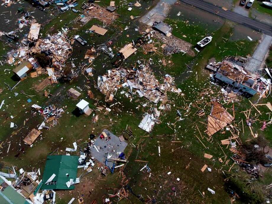 """This aerial view shows damage to a neighborhood by Hurricane Laura outside of Lake Charles, Louisiana, on August 27. - Hurricane Laura slammed into the southern US state of Louisiana Thursday and the monster category 4 storm prompted warnings of """"unsurvivable"""" ocean surges and evacuation orders for hundreds of thousands of Gulf Coast residents. The National Hurricane Center (NHC) said """"extremely dangerous"""" Laura would bring winds of 150 miles per hour (240 kilometers per hour) and """"destructive waves will cause catastrophic damage"""" to Louisiana and Texas. (Photo by STRINGER / AFP) (Photo by STRINGER/AFP via Getty Images) Photo: STRINGER/AFP Via Getty Images / AFP or licensors"""