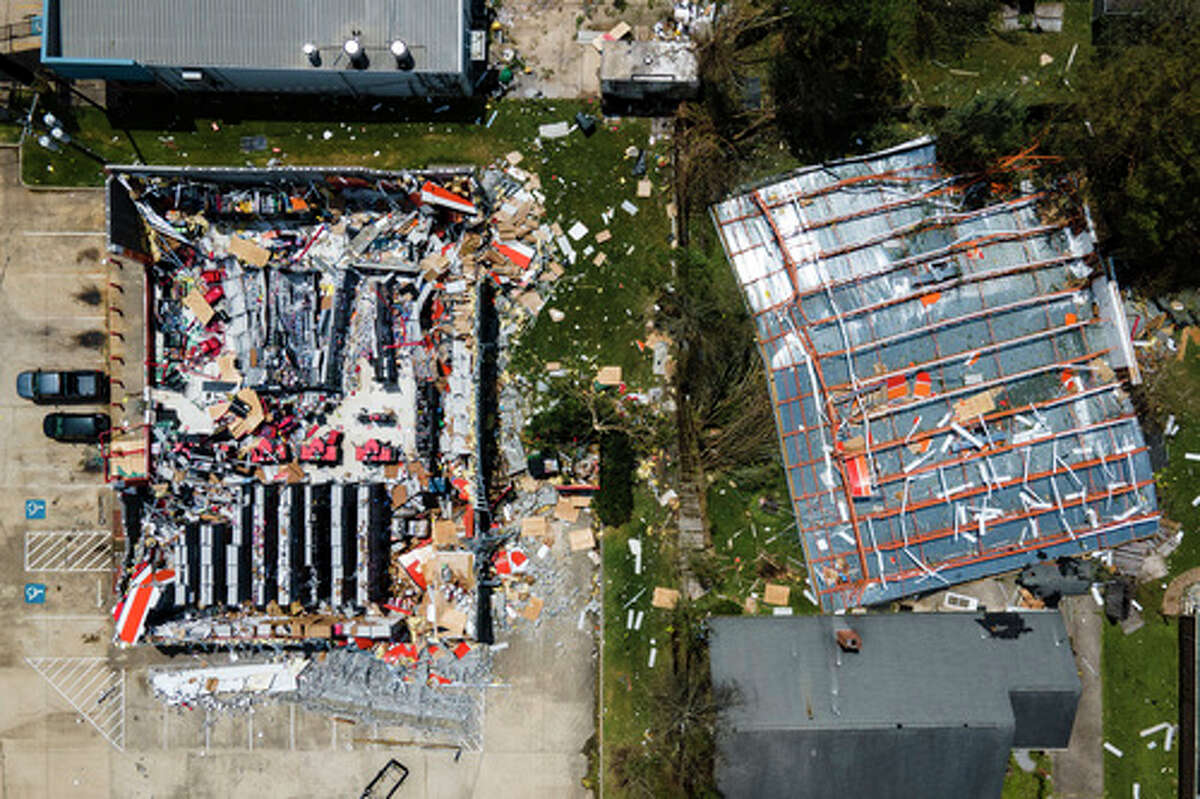 The roof is blown off of an AutoZone store along Nelson Road in the aftermath of Hurricane Laura, Thursday, Aug. 27, 2020, in Lake Charles, LA.