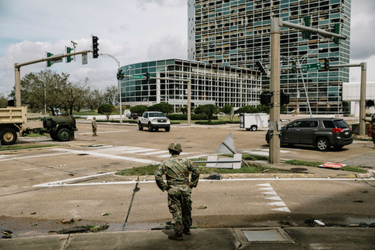 Members of the Army National Guard helped clear downed trees and debris from the streets of downtown Lake Charles, La., on Thursday, Aug. 27, 2020, after Hurricane Laura passed through the region overnight. (William Widmer/The New York Times)