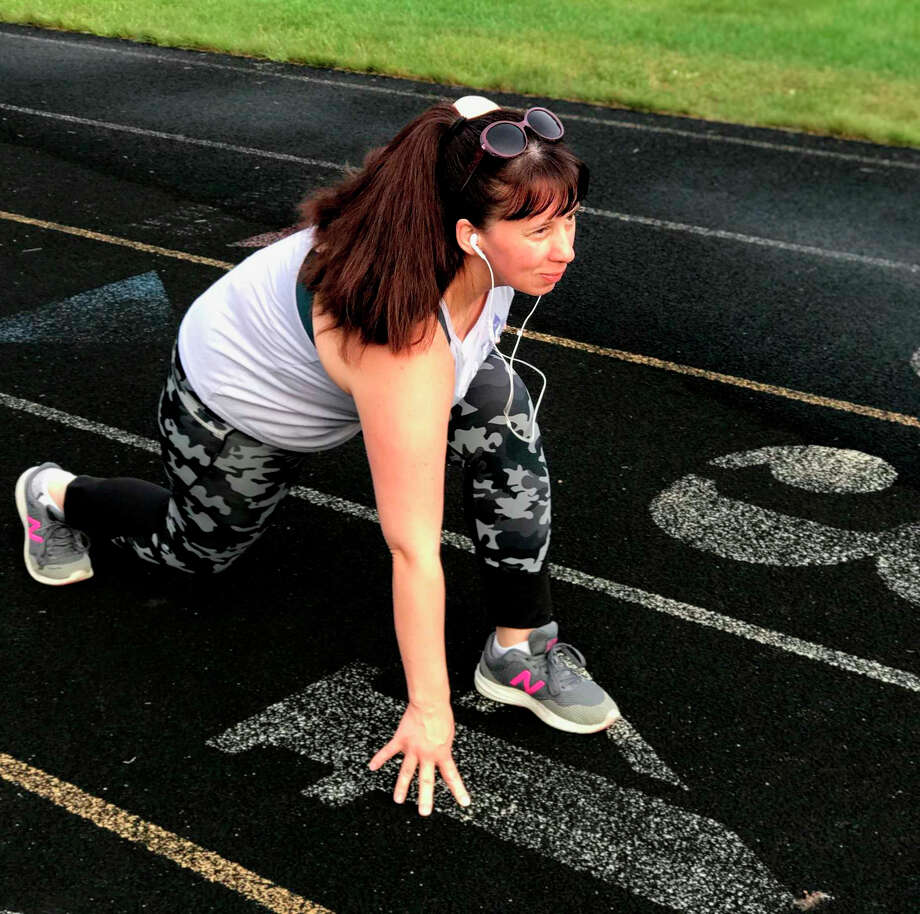 When she isn't working 12-hour shifts, expanding her non-profit, or spending time with her family, Big Rapids resident Leora Bain finds herself lacing her shoes at 7 a.m. in an effort to prepare for her first-ever 5K. According to Bain, this 5K was created to help raise funds and awareness of her non-profit organization, GLIDE. Photo: Courtesy Photo