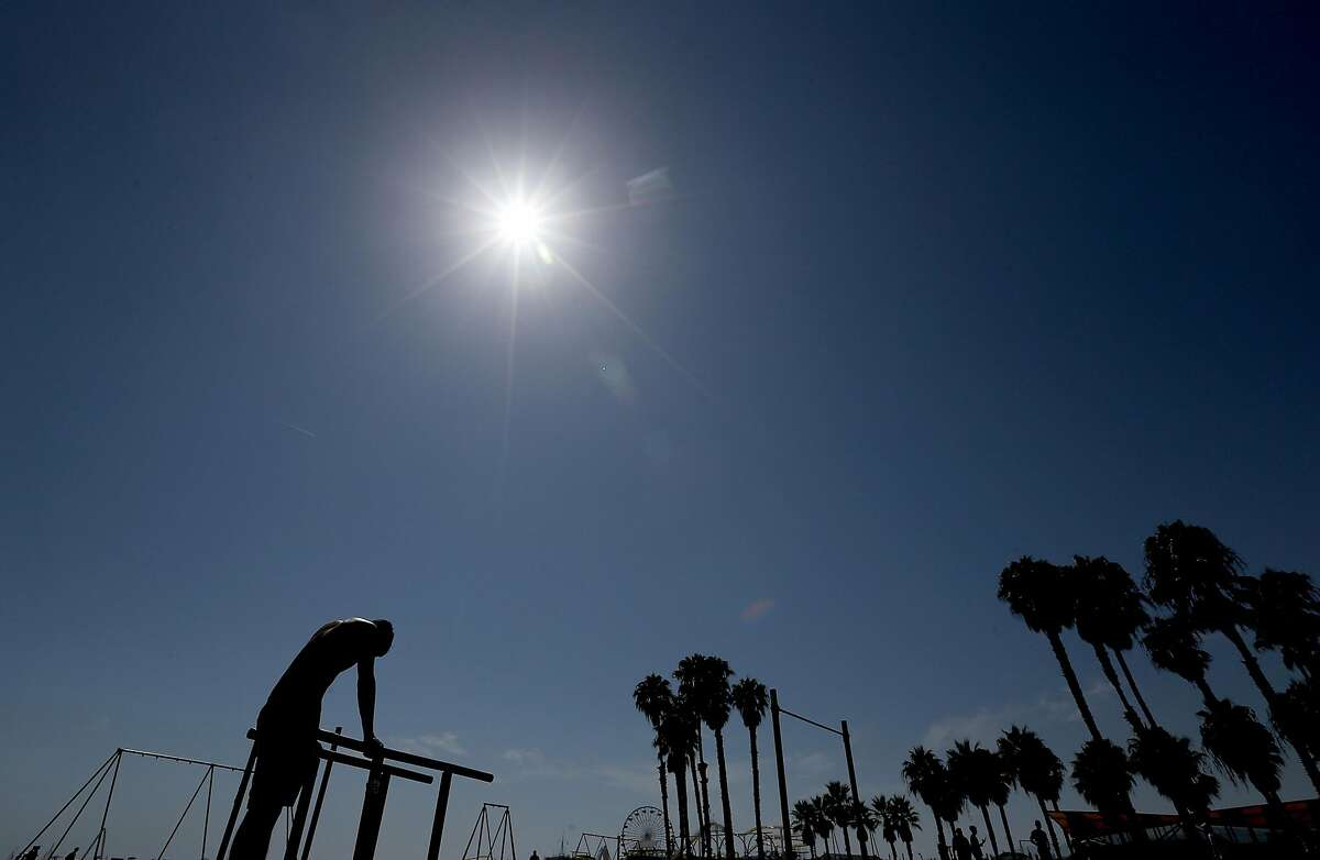 A man pauses while working out under the hot sun in Santa Monica, California, with temperatures reaching triple digits and beyond in inland valleys and deserts, on Saturday, Aug. 15, 2020. A heatwave caused by a high pressure system over southern California is expected to last through next week. (Luis Sinco/Los Angeles Times/TNS)
