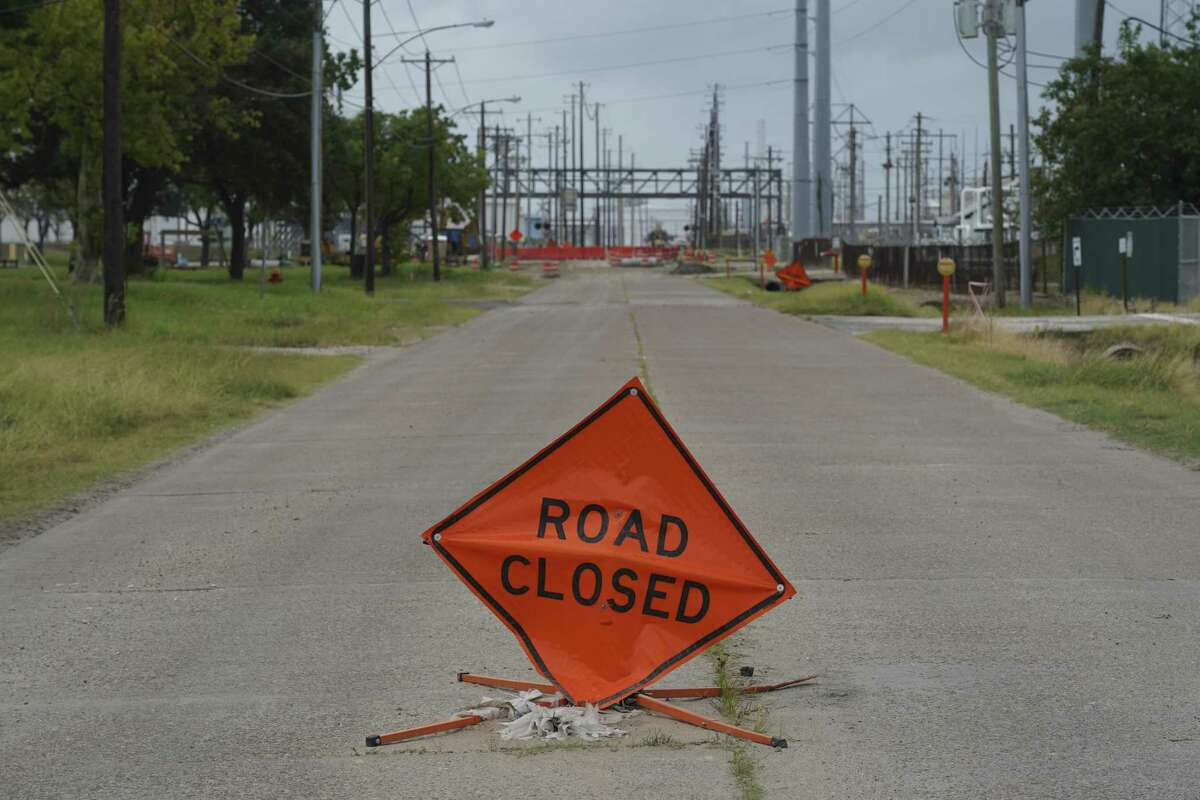"""A 'Road Closed"""" sign stands in front of Marathon Petroleum Corp. Galveston Bay oil refinery plant ahead of Hurricane Laura in Texas City, Texas, U.S., on Wednesday, Aug. 26, 2020."""