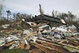 A mobile home was thrown against a tree as Hurricane Laura hit the area Thursday, Aug. 27, 2020, in Grand Lake.